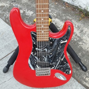 Red stratford baritone with emg pickups battery powered